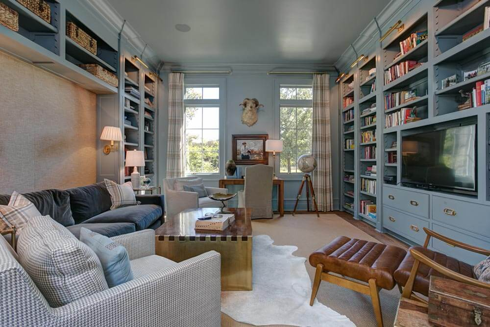 Cozy Blue Library with Gold Accents inside Greek Revival Farmhouse