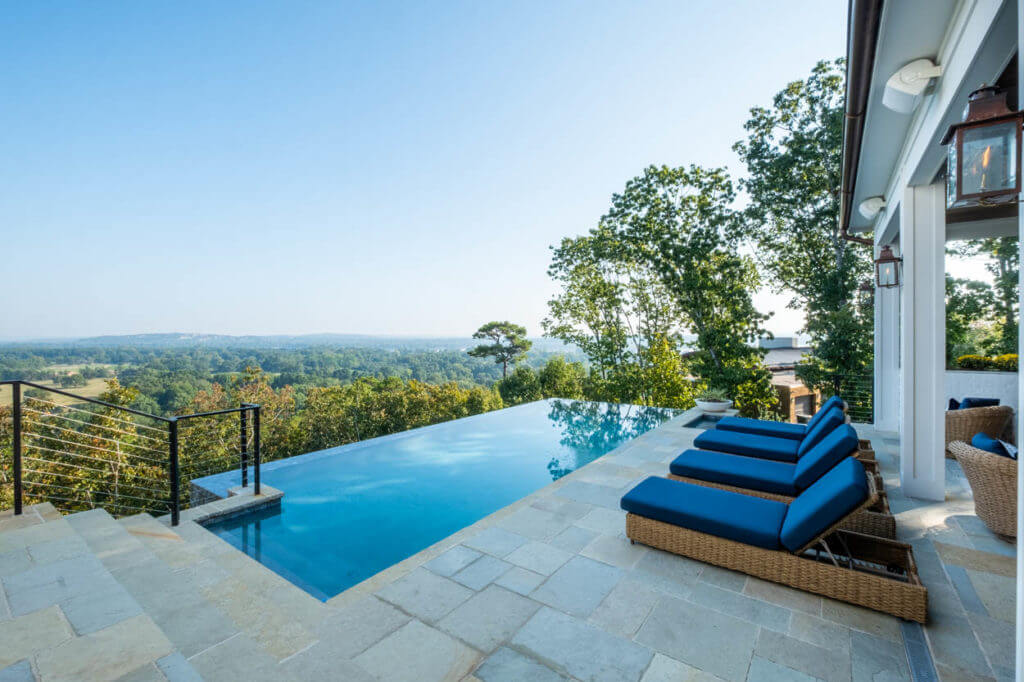 Sharp rectangular infinity pool and patio overlooking a lush Little Rock countryside