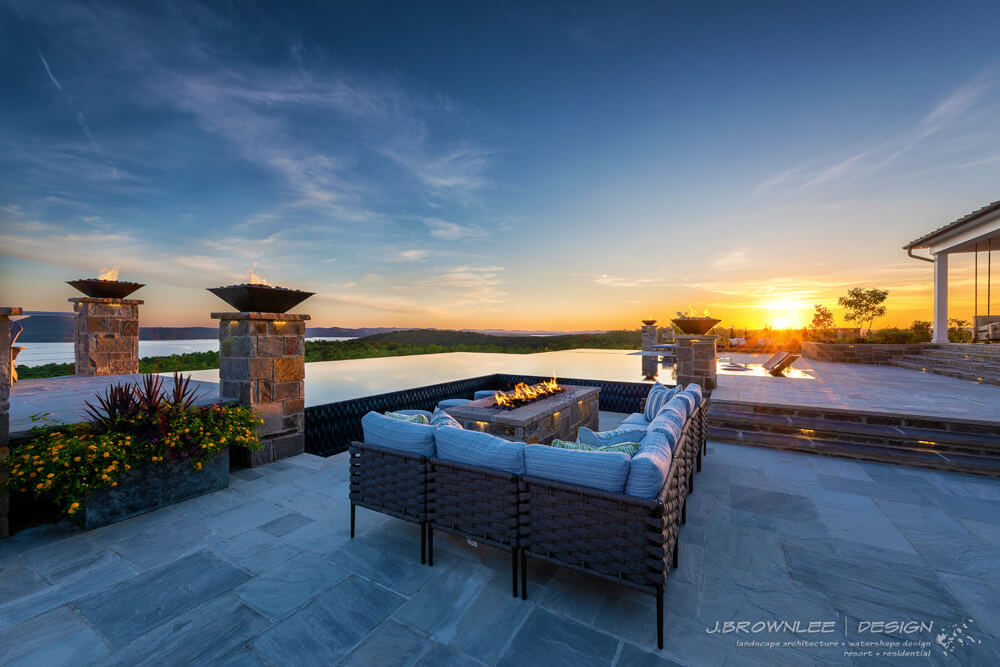 J Brownlee designed pool overlooking lake Maumelle. The pool is an infinity pool with slate lining the outside. It is set in a sunset with rich yellows and deep blues